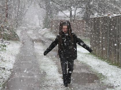 Snowing on Tobias in Laurel, MD